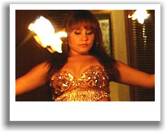 Amy bellydancing with fire sticks