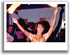 Natasha bellydancing with fire sticks at private function